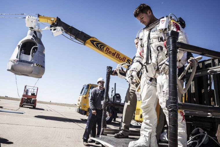 October 9, 2012: Pilot Felix Baumgartner of Austria leaves his capsule after his mission was aborted due to high winds in Roswell, New Mexico. The Austrian daredevil called off his death-defying skydive from a balloon 23 miles (37 km) over the New Mexico desert on Tuesday because of winds at the launch site. (Balazs Gardi/Red Bull Content Pool/Handout/Reuters)