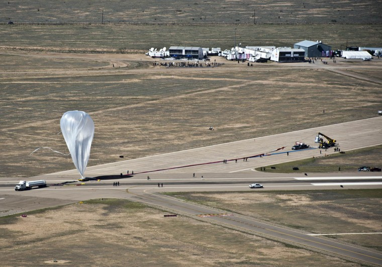 October 9, 2012: The high altitude balloon that will bring Austrian pilot Felix Baumgartner to the stratosphere, twists in the wind just seconds before the skydive was called off during the Red Bull Stratos mission in Roswell, New Mexico. (Predrag Vuckovic/Red Bull Content Pool/Handout/Reuters)