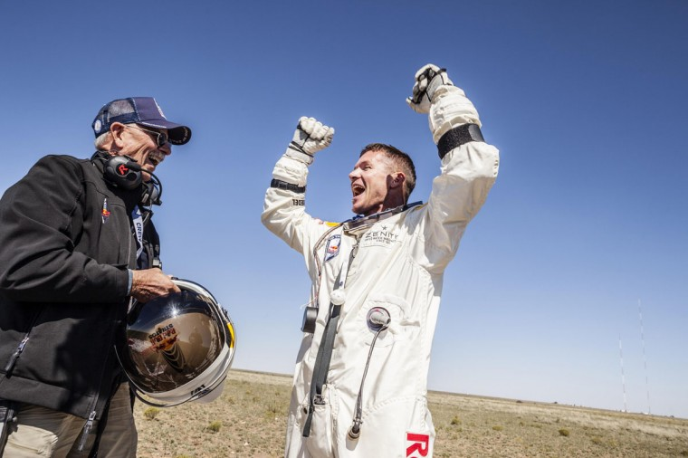 Life support engineer Mike Todd of the U.S. and pilot Felix Baumgartner of Austria celebrate after Baumgartner successfully completed the final manned flight for Red Bull Stratos in Roswell, New Mexico. Baumgartner was attempting to break a 52-year-old record by skydiving from 23 miles (37 km). He also attempted to break the sound barrier while in freefall. (Balazs Gardi/Reuters photo)
