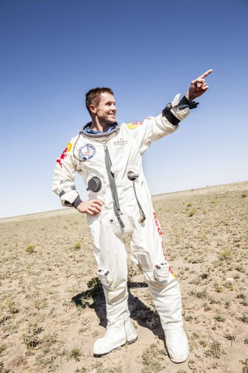 Pilot Felix Baumgartner of Austria celebrates after successfully completing the final manned flight for Red Bull Stratos in Roswell, New Mexico. Baumgartner was attempting to break a 52-year-old record by skydiving from 23 miles (37 km). He also attempted to break the sound barrier while in freefall. (Balazs Gardi/Reuters photo)