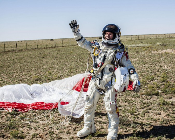 Pilot Felix Baumgartner of Austria celebrates after successfully completing the final manned flight for Red Bull Stratos in Roswell, New Mexico. An Austrian daredevil leapt into the stratosphere from a balloon hovering near the edge of space 24 miles (38 km) above Earth on Sunday, breaking as many as three world records including the highest skydive ever, project sponsors said. (Balaza Gardi/Reuters photo)