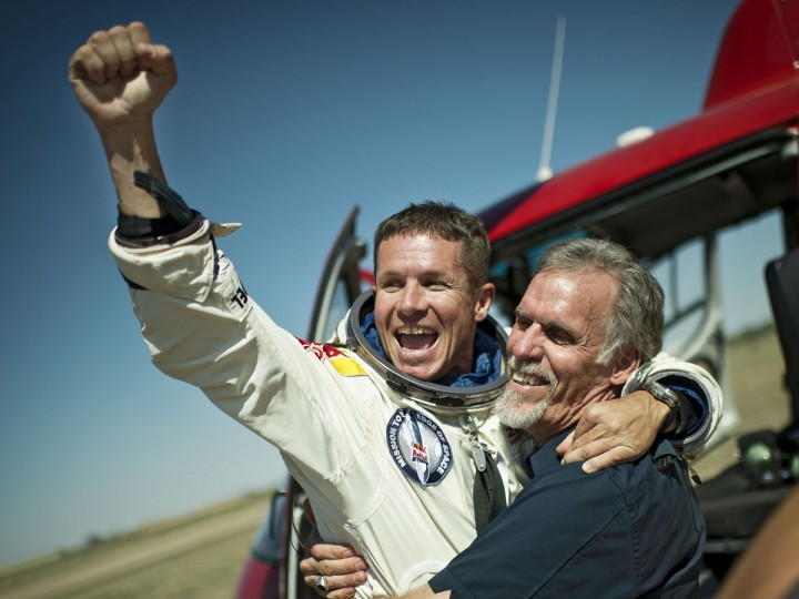 Pilot Felix Baumgartner of Austria and Technical Project Director Art Thompson of the U.S. celebrate after Baumgartner successfully completed the final manned flight for Red Bull Stratos in Roswell, New Mexico. Baumgartner was attempting to break a 52-year-old record by skydiving from 23 miles (37 km). He also attempted to break the sound barrier while in freefall. (Joerg Mitter/Reuters photo)