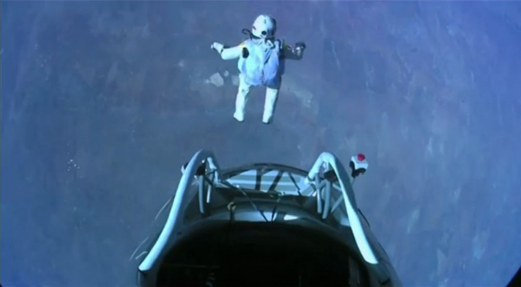 Pilot Felix Baumgartner of Austria exits his capsule as he begins his record-setting skydive over Roswell, New Mexico in this frame capture from handout video. Baumgartner broke a 52-year-old record by skydiving from 23 miles (37 km). (Video frame grab/Reuters photo)