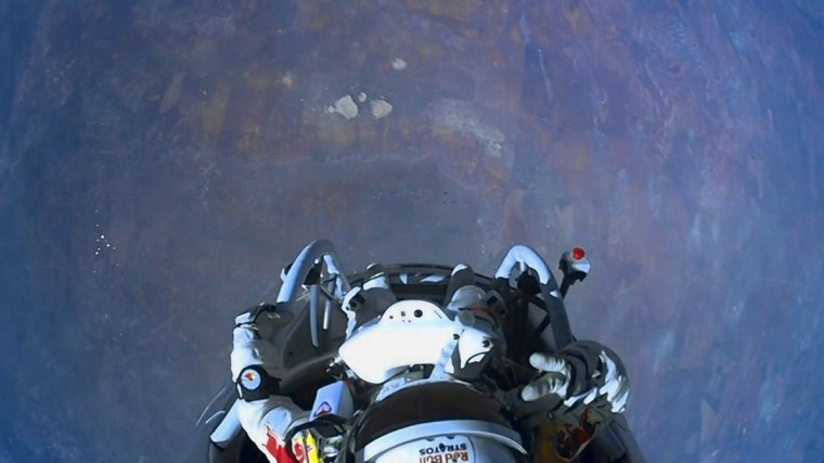 Pilot Felix Baumgartner of Austria salutes before he exits his capsule as he begins his record-setting skydive over Roswell, New Mexico October 14, 2012 in this frame capture released on October 15, 2012. (Red Bull Stratos Content Pool/Handout/Reuters)