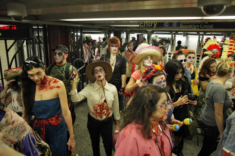 "People dressed up as zombies walk by the New York subway during ""ZOMBIECON."" The event, held during Halloween celebrations, paid homage to the character typically depicted as the mindless walking dead with a penchant for human flesh and brains, made popular in movies, books and comics. (Eduardo Munoz/Reuters)"