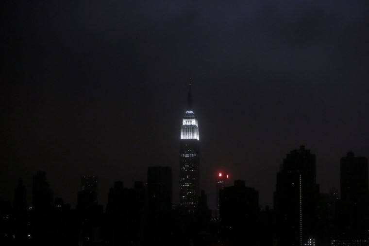 A blacked out New York City skyline is seen from Brooklyn, New York, October 29, 2012 as Hurricane Sandy made landfall in the northeastern United States. Hurricane Sandy began battering the U.S. East Coast on Monday with fierce winds and driving rain, as the monster storm shut down transportation, shuttered businesses and sent thousands scrambling for higher ground hours before the worst was due to strike. (Gary He/Reuters)