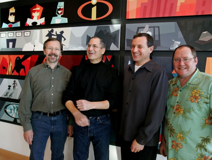 January 24, 2006: Walt Disney Co. CEO Robert Iger, center right, smiles with Pixar Animation Studios Inc. CEO Steve Jobs, center left, at Pixar headquarters in Emeryville, California after Disney announced it is buying longtime partner Pixar. Also smiling is Pixar Executive Vice President of Creative, John Lasseter, right, and Ed Catmull, President of Pixar, left. (Paul Sakuma/AP Photo)
