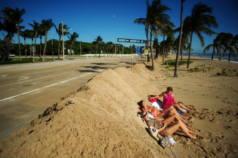 October 29, 2012: A group of tourists from Argentina were not going to let a little sand from Hurricane Sandy ruin their vacation, Monday at Ft. Lauderdale Beach. (Joe Cavaretta/SunSentinel)