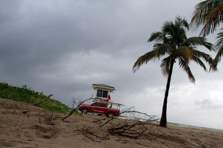 October 26, 2012: A rescue truck is stationed at Tower 5 on Ft. Lauderdale Beach as storm debris is shown washed up on the beach on Friday as Hurricane Sandy passes to the east. (Amy Beth Bennett/Sun Sentinel)
