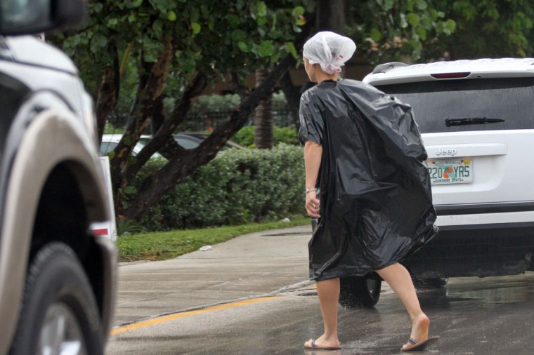 October 26, 2012: A woman dressed in bags crosses Seabreeze Blvd. on Ft. Lauderdale Beach on Friday as Hurricane Sandy passes to the east. (Amy Beth Bennett/Sun Sentinel)