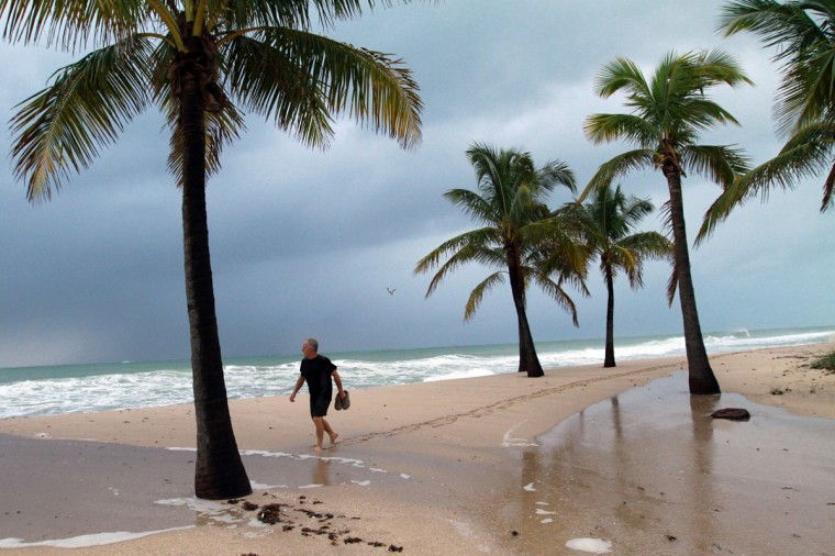 October 26, 2012: Tim King, from the city of Sault Ste Marie Ontario Canada, walks along Ft. Lauderdale Beach as a storm surge pushes water high up on the sand on Friday as Hurricane Sandy passes to the east.(Amy Beth Bennett/Sun Sentinel)