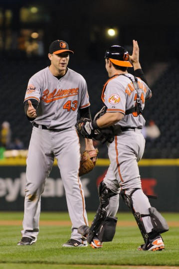 Sept. 20: Marathon men. Baltimore Orioles relief pitcher Jim Johnson (43) and catcher Taylor Teagarden (31) react to defeating the Seattle Mariners in the 11th inning at Safeco Field. (Steven Bisig/US Presswire)