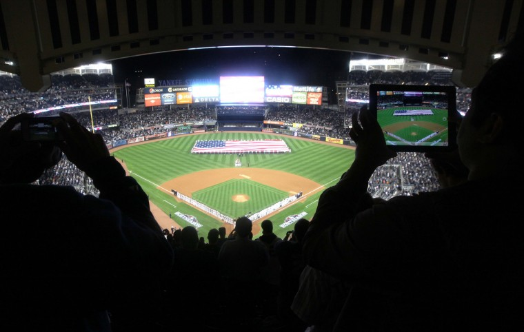 West Point Cadets hold a giant American flag in center field as the National Anthem is played before game three of the 2012 ALDS between the New York Yankees and the Baltimore Orioles at Yankee Stadium. (John Munson/The Star-Ledger)
