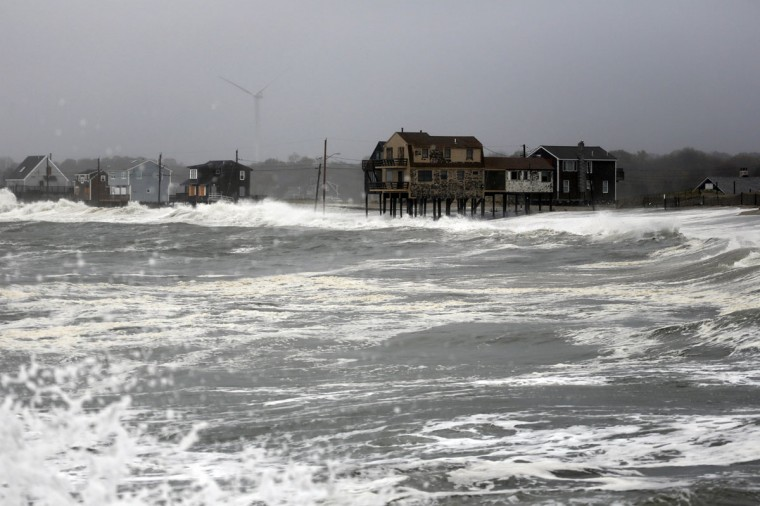 October 29, 2012: Waves from Hurricane Sandy crash against homes on Peggotty Beach in Scituate, Massachusetts an hour before high tide. (Greg M. Cooper/US Presswire)