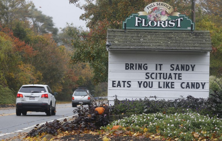October 29, 2012: The marquee sign in front of Kennedy's county gardens welcomes the arrival of Hurricane Sandy to Scituate, Massachusetts. (Greg M. Cooper/US Presswire)