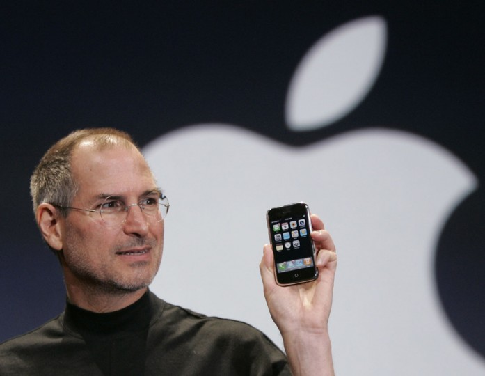 January 9, 2007: Apple CEO Steve Jobs holds up an Apple iPhone at the MacWorld Conference in San Francisco, California. (Paul Sakuma/AP Photo)