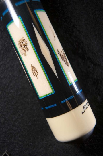 Detail of the intricate designs, on the wooly mammoth inlays, embedded in the butt sleeve of a pool cue at Joss Cues. (Karl Merton Ferron/Baltimore Sun)