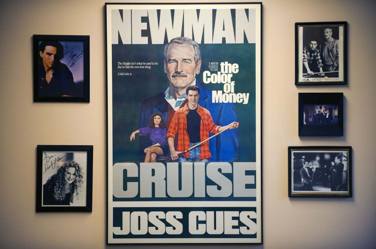 "Production stills surround a movie poster of the 1986 film, ""The Color of Money,"" starring Paul Newman and Tom Cruise, on display at Joss Cues. Joss cues were featured in the movie. Joss Cues has made cues for Tom Cruise, Nicole Kidman, Paul Newman, Dustin Hoffman, Jimmy Connors and the entire starring cast of TV's Mission Impossible. (Karl Merton Ferron/Baltimore Sun)"