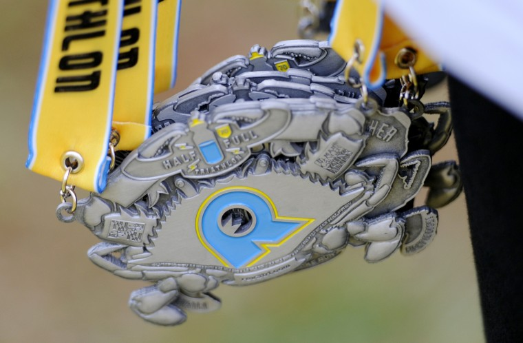 A close-up of the medals given to finishers of the Half Full Triathlon. (Jon Sham/BSMG)