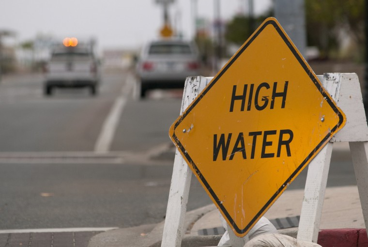 High water warning signs line Baltimore Avenue and Dorcesheter Streets after Ocean City Public Works crews placed them along the road as Ocean City anticipates flooding in the South end of the island. (Grant L. Gursky/Daily Times)