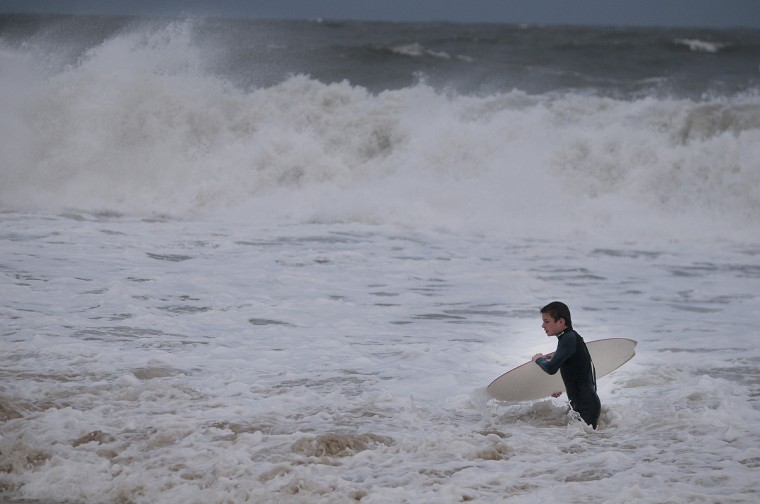 Francis Perzanowski, 14, of Annapolis, takes advantage of the high surf to skimboard along the beach Saturday afternoon in Ocean City near 17th Street. (Grant L. Gursky/Daily Times)