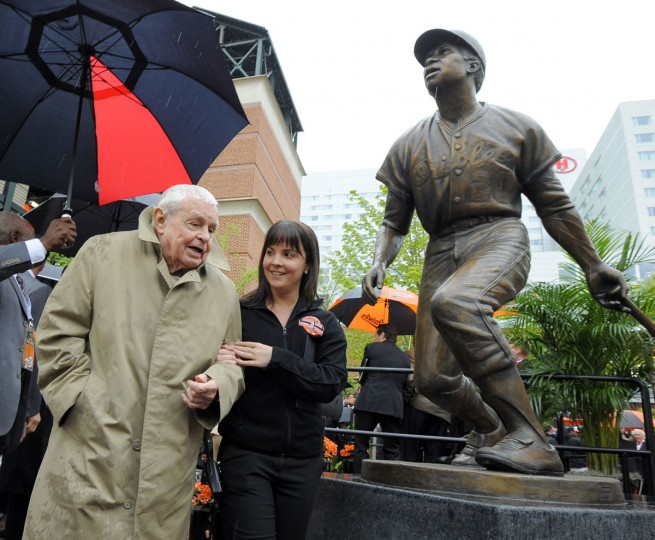 Former Oriole manager Earl Weaver walks by the Frank Robinson statue. The Baltimore Orioles honored Hall of Famer Frank Robinson by unveiling a Frank Robinson statue at Oriole Park at Camden Yards. (Lloyd Fox/Baltimore Sun)