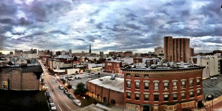 BEST SKYLINE: This photograph was snapped with an iPhone 4, using the 360 Panorama app and effects from the Camera+ app. It was taken from the roof of the parking garage on the 1000 block of N. Charles Street, next to the Belvedere. (Photo by Paul Gardner)