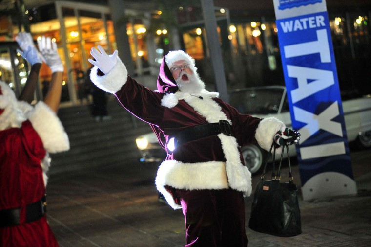 Santa makes his grand entrance at Harbor Place on November 19, 2010. (Monica Lopossay/Baltimore Sun)