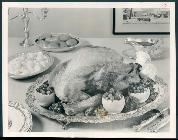 1963: A modern Thanksgiving table little resembles the Pilgrims' table in 1621, but traditional foods, especially the turkey, remain much the same. Here the noble bird is flanked with cranberries, oranges, onions and glazed sweet potatoes. (Baltimore Sun)