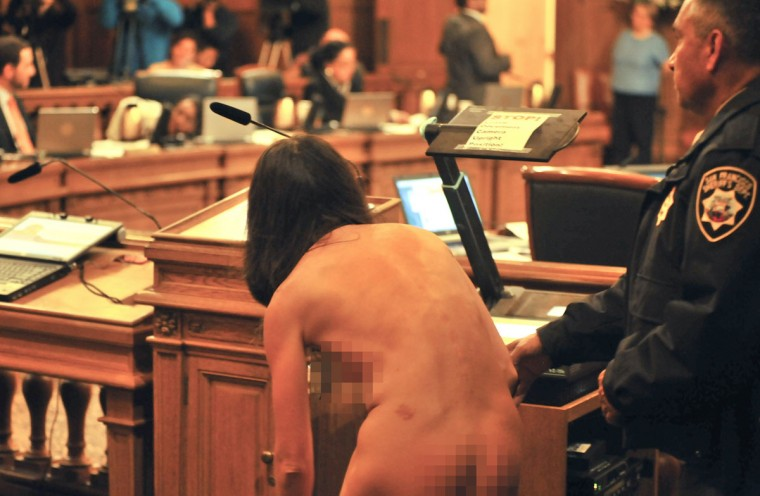 A protester disrobes inside San Francisco's City Hall after the Board of Supervisors approved a ban on public nudity on November 20, 2012. (Josh Edelson/AFP/Getty Images)