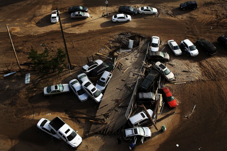 Abandoned and flooded cars are viewed in the heavily damaged Rockaway neighborhood, in Queens where a large section of the iconic boardwalk was washed away in New York. (Spencer Platt/Getty Images)