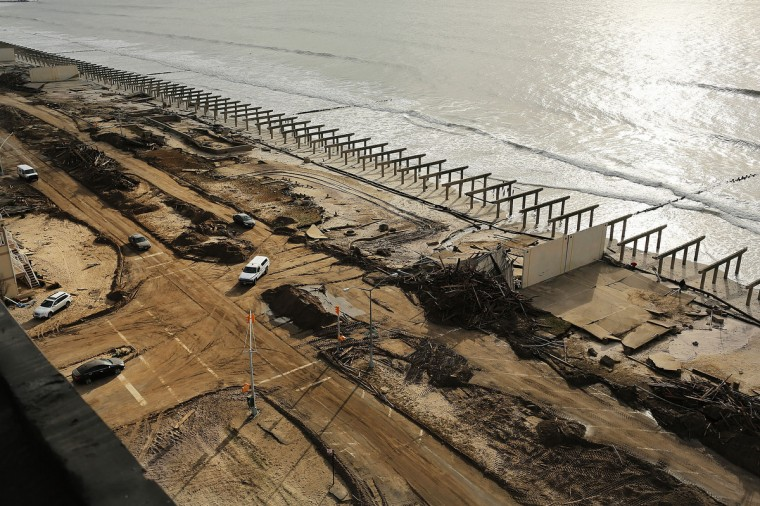 Debris piles up near the foundations of the historic Rockaway boardwalk in Queens after it was washed away during superstorm Sandy. (Spencer Platt/Getty Images)