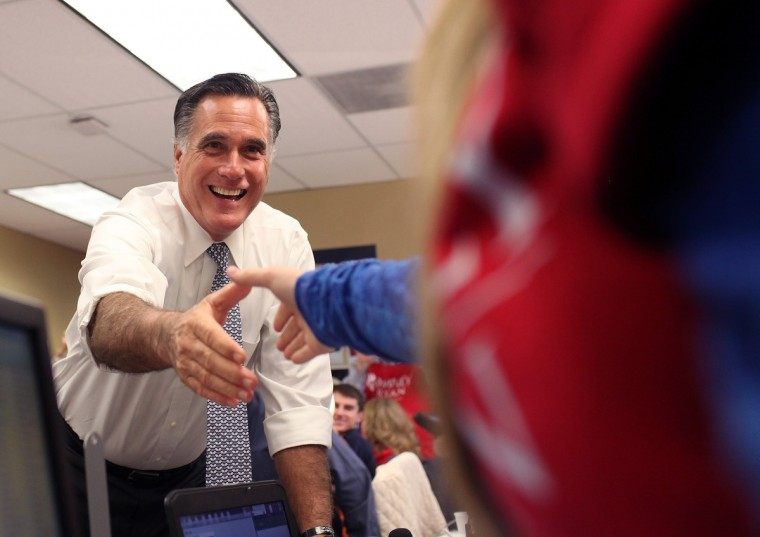 Republican presidential candidate, former Massachusetts Gov. Mitt Romney greets workers at call center on November 6, 2012 in Pittsburgh, Pennsylvania. The presidential race remains tight as Americans are heading to the polls to cast their ballots. (Justin Sullivan/Getty Images)