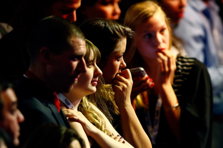 People in attendance react in the crowd while watching election results displayed on a television during Mitt Romney's campaign election night event at the Boston Convention & Exhibition Center on November 6, 2012 in Boston, Massachusetts. Voters went to polls in the heavily contested presidential race between incumbent U.S. President Barack Obama and Republican challenger Mitt Romney. (Matthew Cavanaugh/Getty Images)