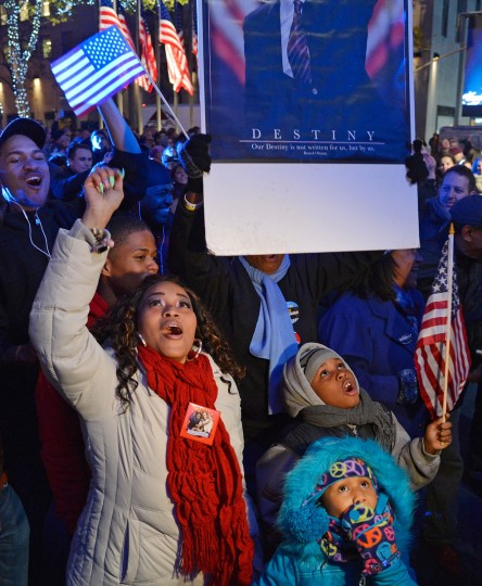 Spectators cheer in celebration of the 2012 Presidential election night on November 6, 2012 in Times Square, New York City. (Mike Coppola/Getty Images)