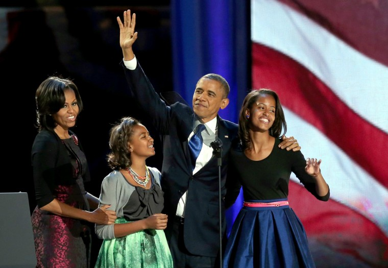 U.S. President Barack Obama walks on stage with first lady Michelle Obama and daughters Sasha and Malia to deliver his victory speech on election night at McCormick Place November 6, 2012 in Chicago, Illinois. Obama won reelection against Republican candidate, former Massachusetts Governor Mitt Romney. (Win McNamee/Getty Images)