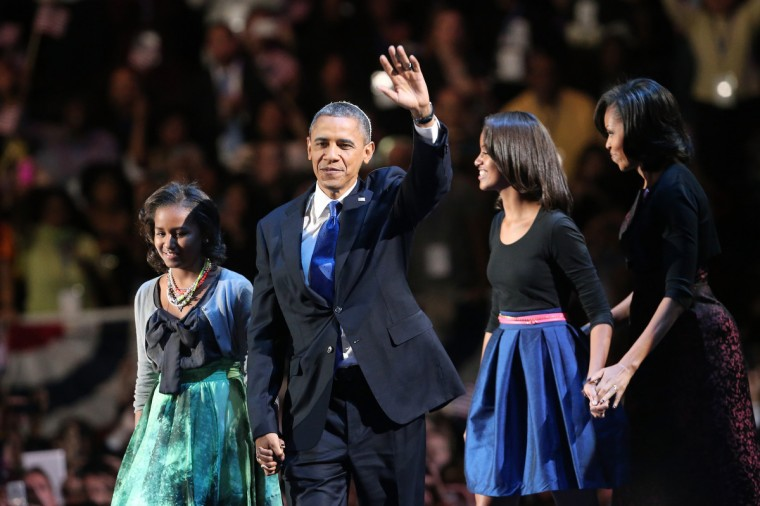 U.S. President Barack Obama walks on stage with first lady Michelle Obama and daughters Sasha and Malia to deliver his victory speech on election night at McCormick Place November 6, 2012 in Chicago, Illinois. Obama won reelection against Republican candidate, former Massachusetts Governor Mitt Romney. (Spencer Platt/Getty Images)