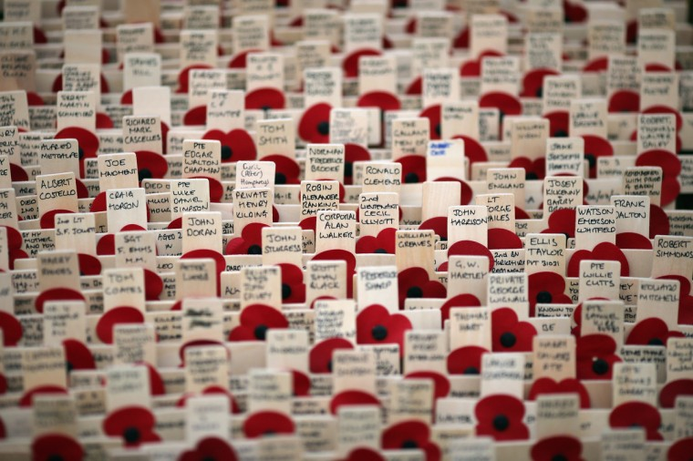 Remembrance crosses stand outside Westminster Abbey ahead of the official opening of the Royal British Legion's Field of Remembrance in London, England. Hundreds of small crosses bearing a poppy have been planted in the Field of Remembrance to pay tribute to British servicemen and women who have lost their lives in conflict. (Dan Kitwood/Getty Images)
