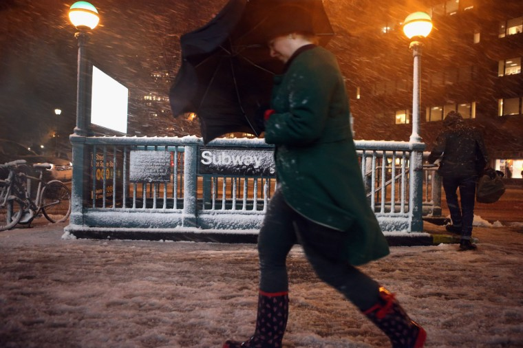 Pedestrians walk through high winds and snow near Union Square on November 7, 2012 in New York City. The city was hit by a Nor'Easter storm, just ten days after Superstorm Sandy ravaged the tri-state area. (John Moore/Getty Images)