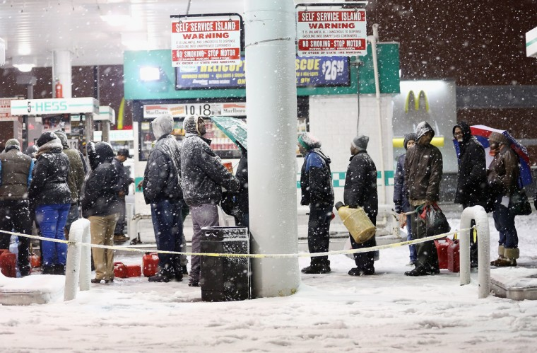 People wait on line to buy gasoline during a Nor'Easter snowstorm on November 7, 2012 in the Brooklyn borough of New York City. The city is still experiencing long gas lines in the wake of Superstorm Sandy. (Mario Tama/Getty Images)