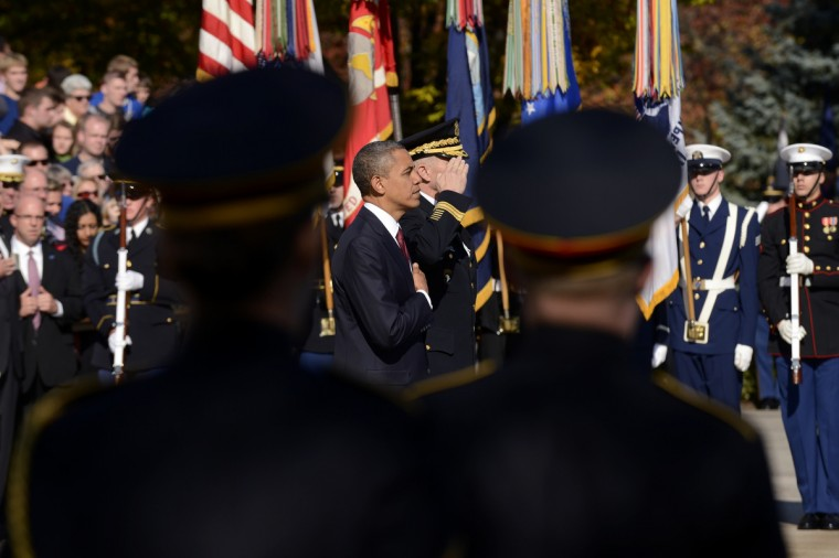 U.S. President Barack Obama and Major General Michael S. Linnington, Commander of the US Army Military District of Washington participate in a wreath-laying ceremony on Veteran's Day at the Tomb of the Unknown Soldier in Arlington National Cemetery on November 11, 2012 in Arlington, Virginia. (Michael Reynolds/Getty Images)