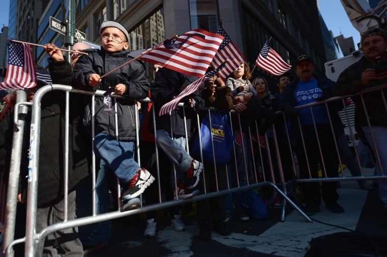 Spectators watch the Veteran's Day Parade on November 11, 2012 in New York City. Former Mayor Ed Koch is the grand marshal for the parade, which expects to draw thousands of spectators and is the commemoration of the 50th anniversary of the start of the Vietnam War. (Michael Loccisano/Getty Images)
