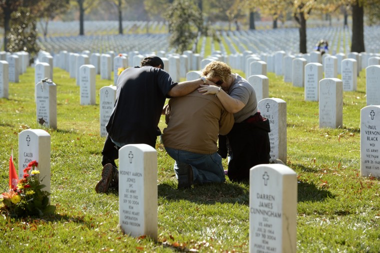 Mourners console each other on Veteran's Day at the Tomb of the Unknown Soldier in Arlington National Cemetery on November 11, 2012 in Arlington, Virginia. Section 60 is the final resting place for the majority of casualties Operation Iraqi Freedom in Iraq and Operation Enduring Freedom in Afghanistan. (Michael Reynolds/Getty Images)