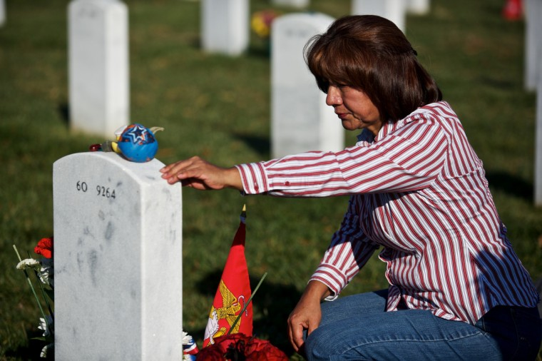 Maria Rodriquez visits the grave of her son Ronald Rodriguez on Veteran's Day at Arlington National Cemetery on November 11, 2012 in Arlington, Virginia. (Lexey Swall/Getty Images)