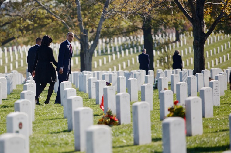 U.S. President Barack Obama and first lady, Michelle, walk through Arlington National Cemetery after greeting family members of fallen service men and women on Veteran's Day November 11, 2012 in Arlington, Virginia. (Lexey Swall/Getty Images)