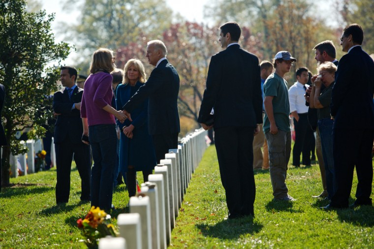 U.S. Vice President Joe Biden and his wife, Dr. Jill Biden, greet family members of fallen service men and women on Veteran's Day at Arlington National Cemetery on November 11, 2012 in Arlington, Virginia. (Lexey Swall/Getty Images)
