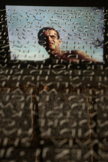 A photograph of a member of the U.S. military is reflected in the marble face of the Vietnam Veterans Memorial on the day after Veterans Day, November 12, 2012 in Arlington, Virginia. The federal government observed Veterans Day by giving employees Monday off from work. (Chip Somodevilla/Getty Images)