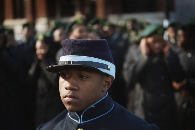 Jeffrey Carodine and other students from the Chicago Military Academy participate in the Chicago Veterans Day parade on November 12, 2012 in Chicago, Illinois. Veterans Day, held the anniversary of the signing of the armistice which ended the World War I, is celebrated to honor all veterans for their service. (Scott Olson/Getty Images)