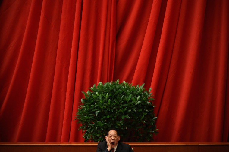 A scientist delegate yawns at stage during the closing session of the 18th National Congress of the Communist Party of China (CPC) inside the Great Hall of the People in Beijing, China. Members of the Standing Committee of the Political Bureau of the new CPC Central Committee will meet with journalists on November 15, 2012. (Feng Li/Getty Images)