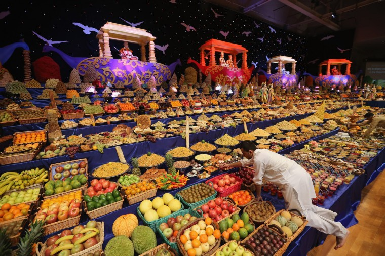 Food is placed on the main stage as Sadhus and Hindu men celebrate Diwali at the BAPS Shri Swaminarayan Mandir in London, England. Diwali, which marks the start of the Hindu New Year, is being celebrated by thousands of Hindu men women and children in the Neasden mandir, which was the first traditional Hindu temple to open in Europe. (Dan Kitwood/Getty Images)